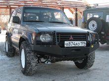 Бампер OJ передний Pajero II с площадкой,вырезами под ПТФ и защитой фар