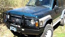 Бампер OJ передний Nissan Patrol 60 с площадкой под лебедку, защитой фар, кронштейном допсвета